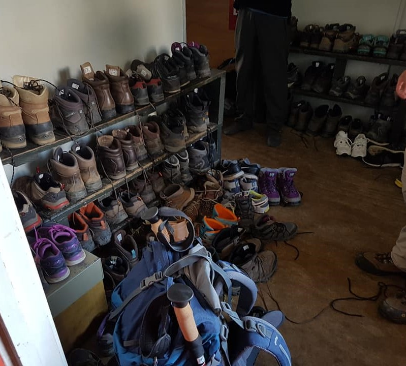 Many shoes at Luxmore Hut